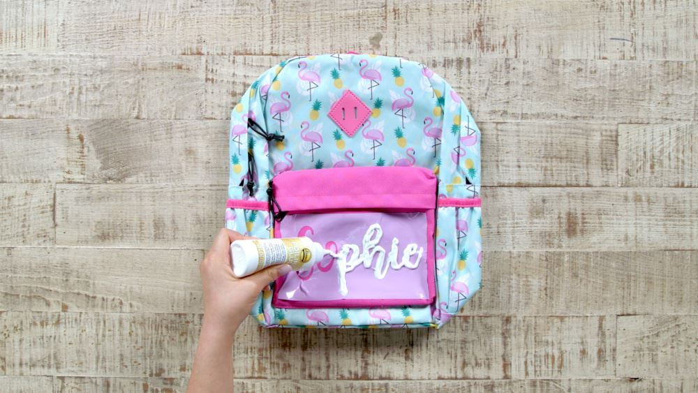 Aleene's Personalize a Backpack with Foiling Glue - apply glue to stencil openings