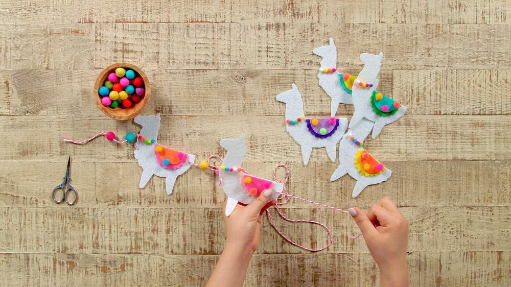 Aleene's DIY Felt Llama Garland - thread llamas onto twine