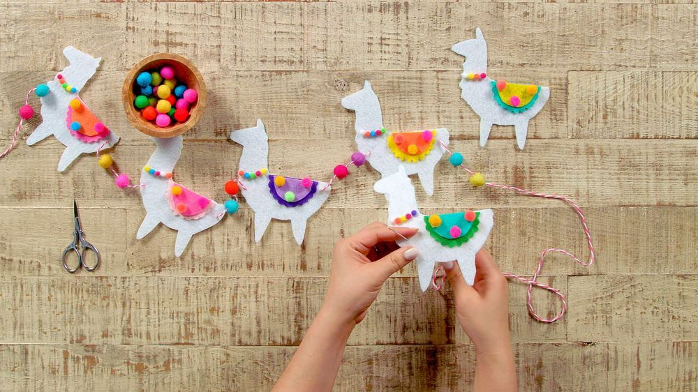 Aleene's DIY Felt Llama Garland - continue threading llamas and felt balls