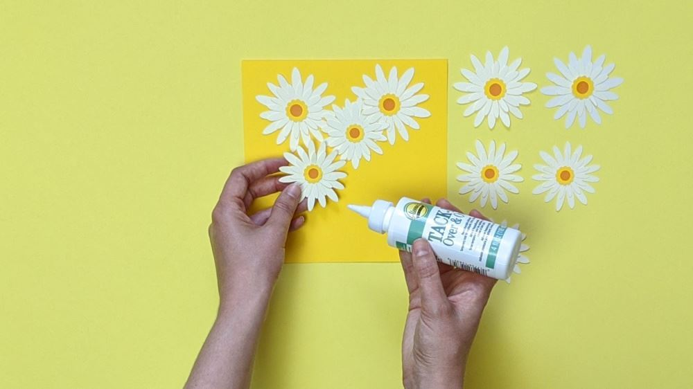 Aleene's Mother's Day Card DIY - glue daisies to front of card