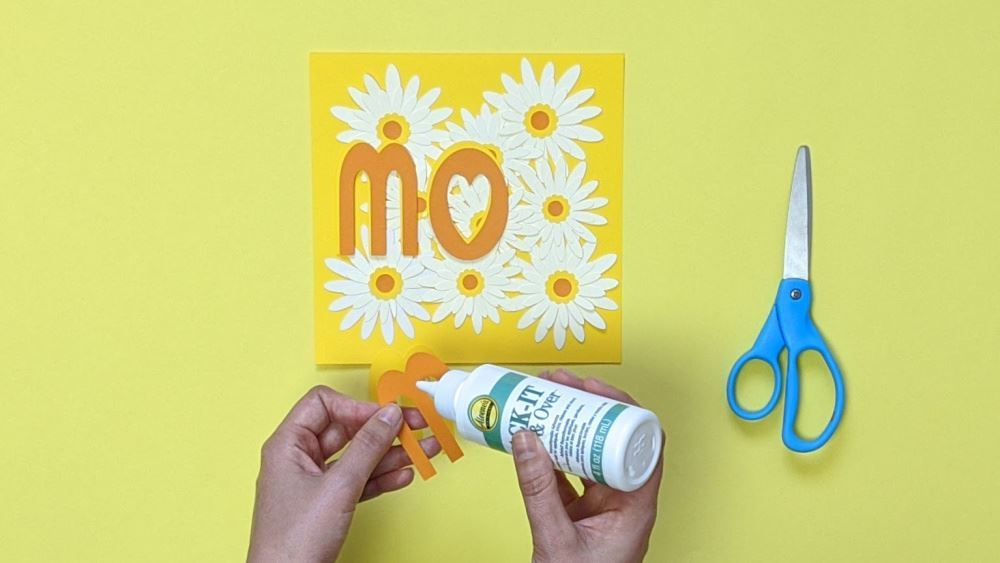 Aleene's Mother's Day Card DIY - glue mom lettering over daisies