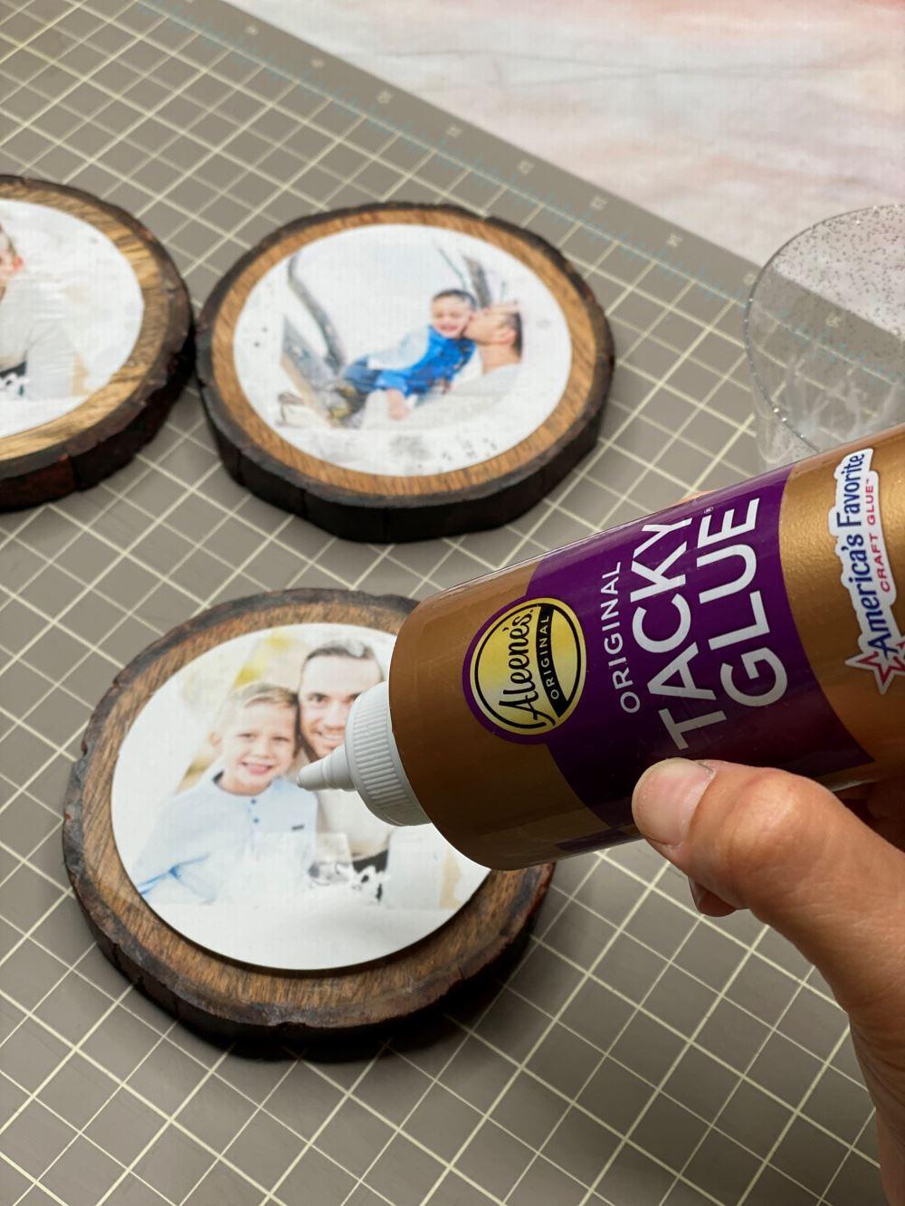 Glue each photo onto a coaster