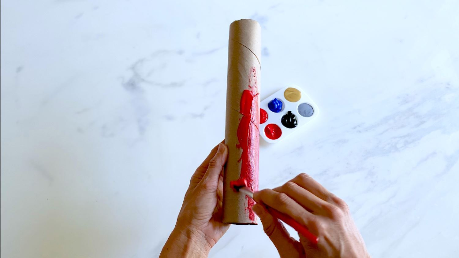 Paint one of the paper towel tubes