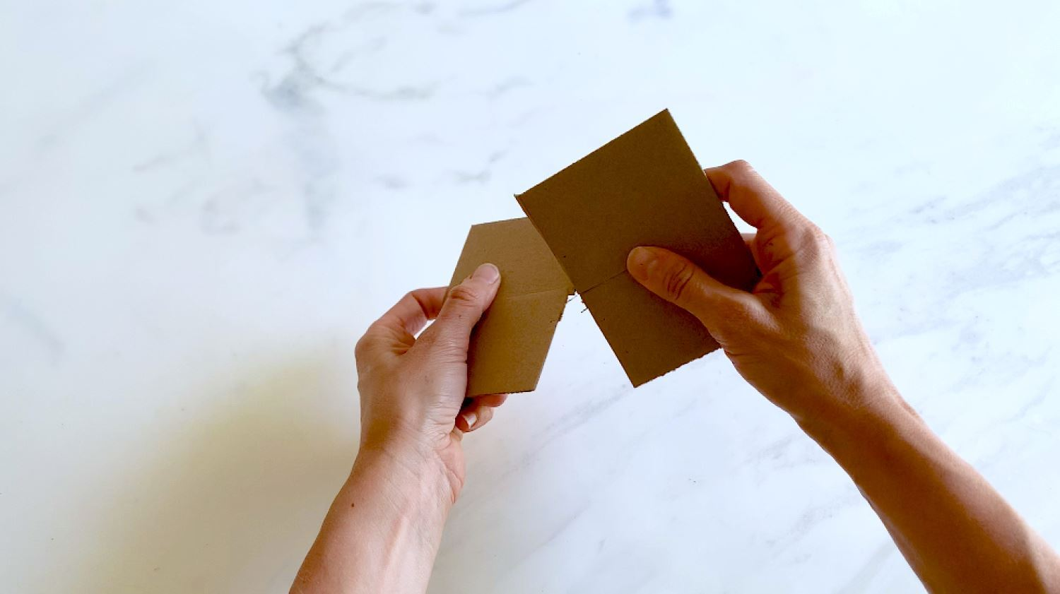 Cut and merge cardboard squares for base