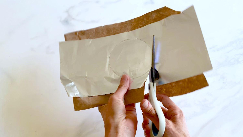 Glue craft paper to foil and cut circles