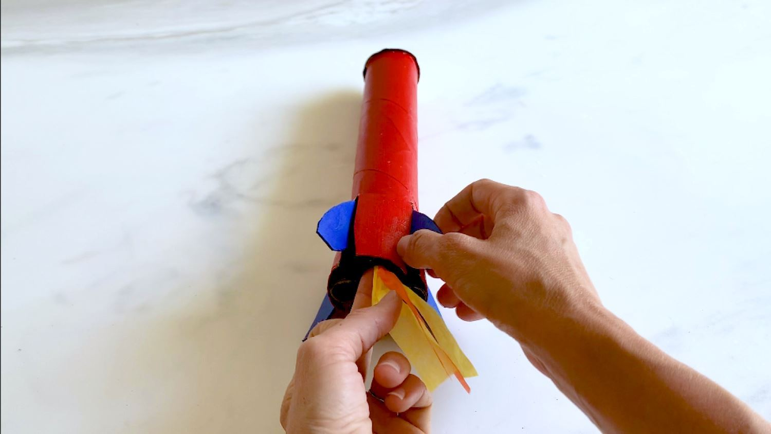 Glue tissue paper flames to base