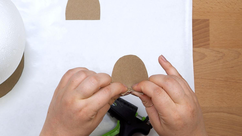 Cut slits into each ear base and fold inward