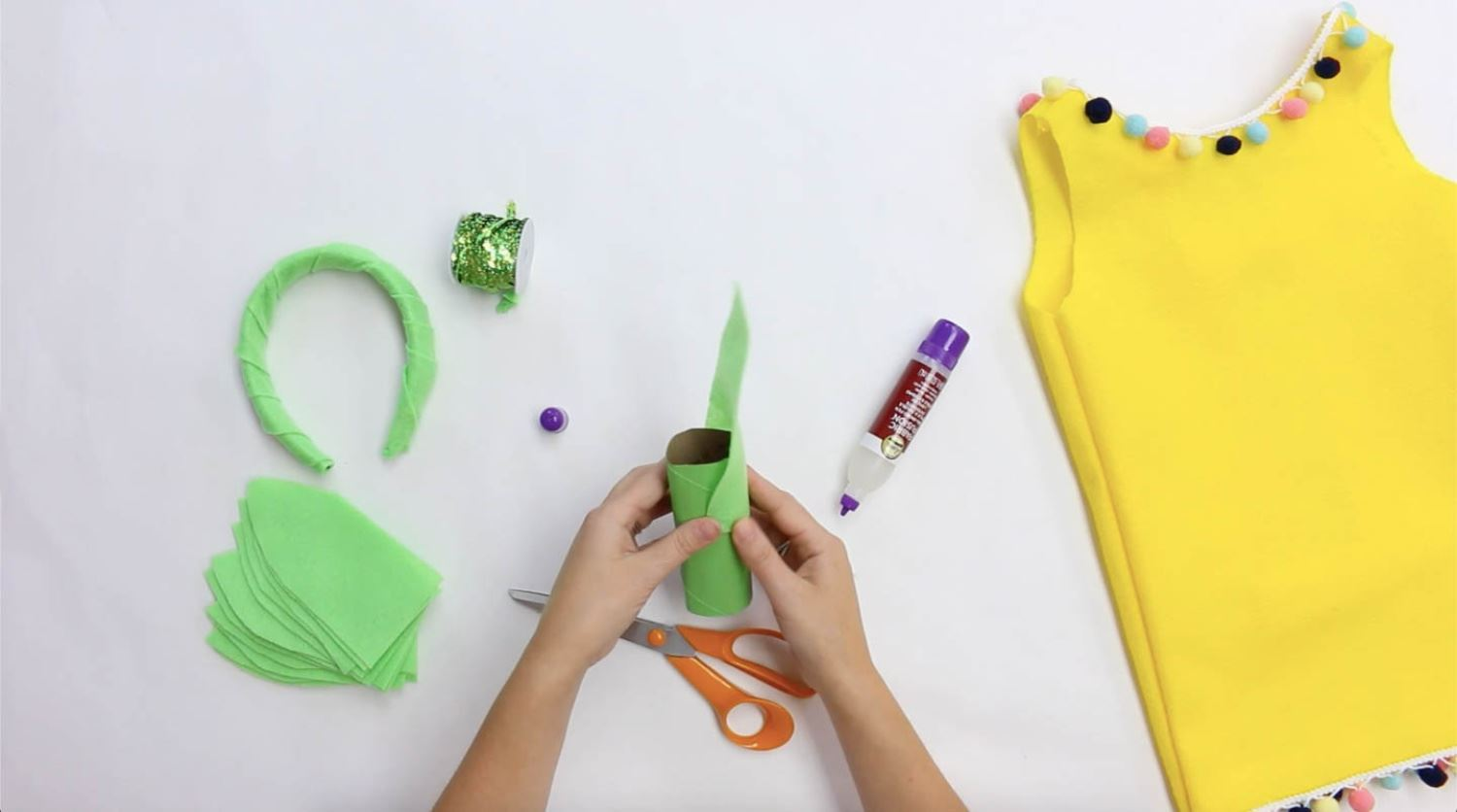Cut out leaf shapes and paint tube green