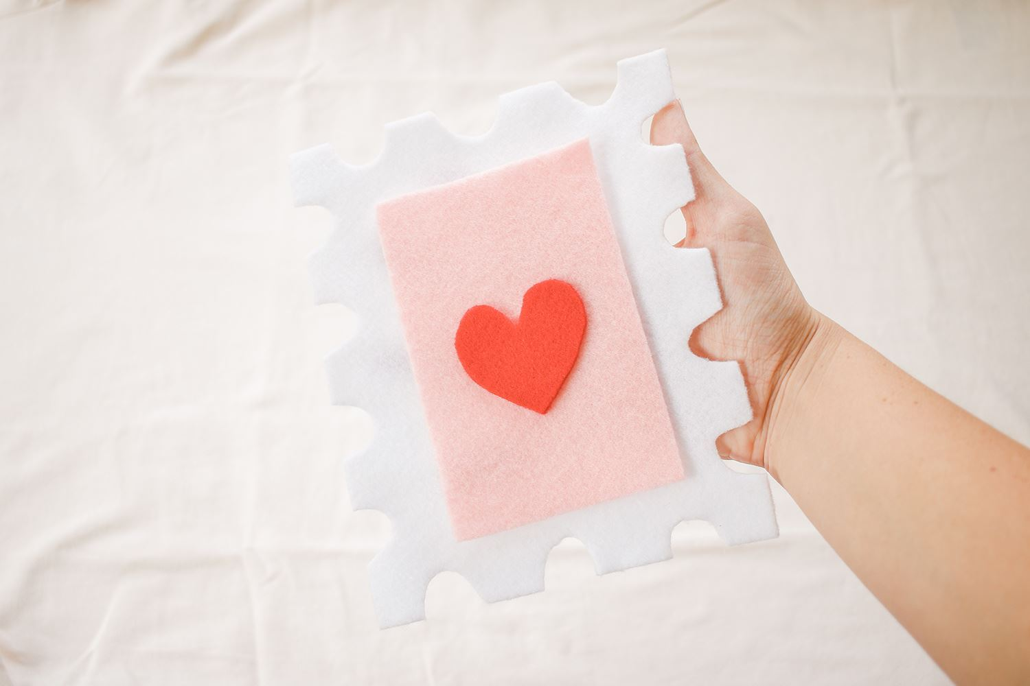 Glue heart and rectangle onto stamp cutout