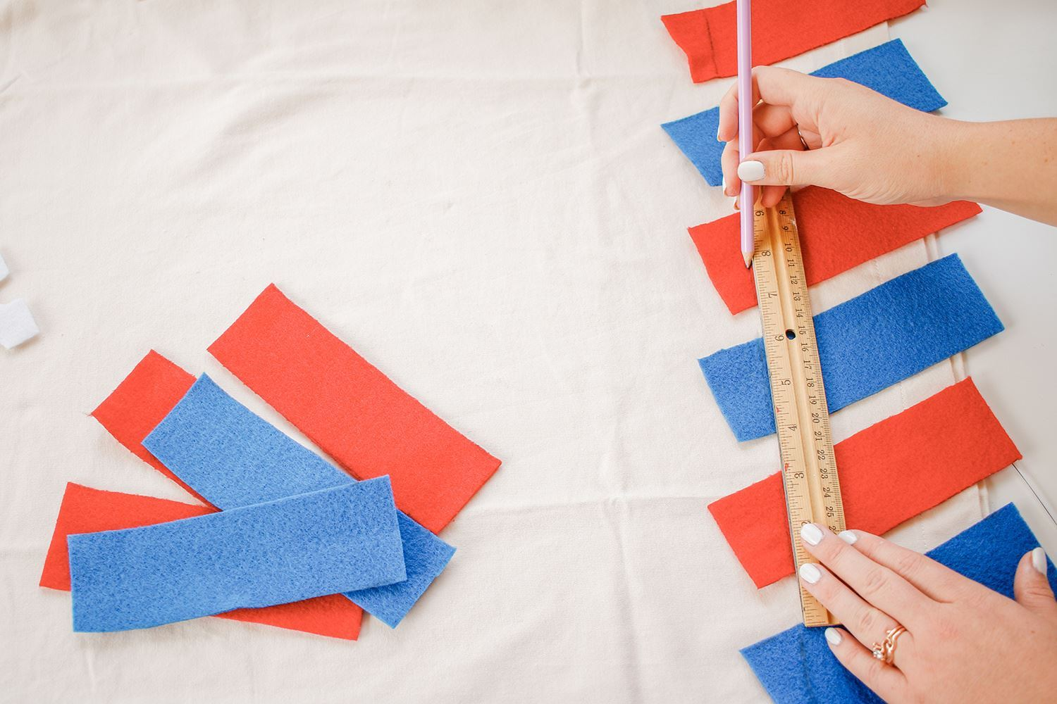 Mark ends of red and blue felt strips with pencil