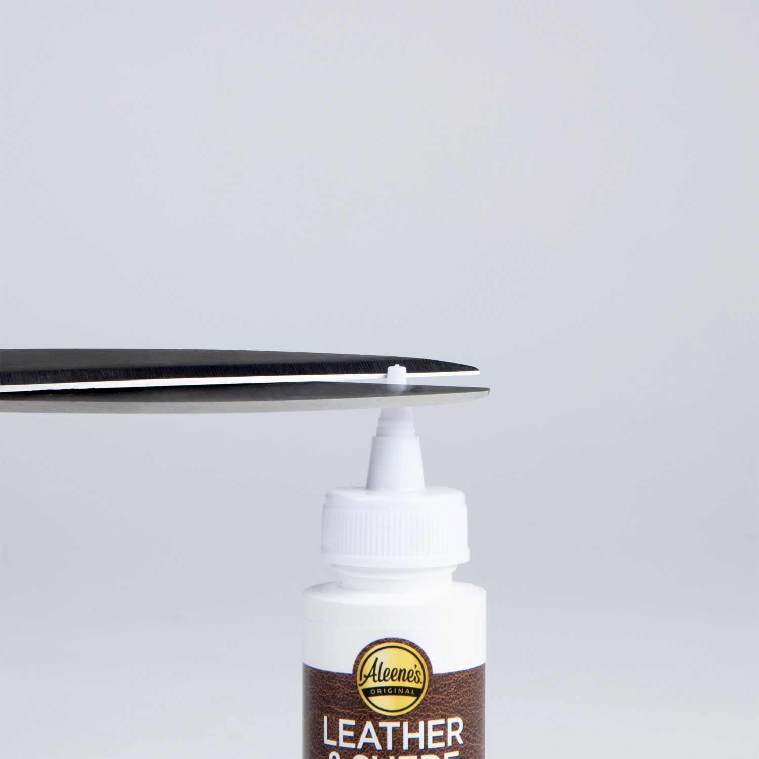 Aleene's Leather & Suede Glue Cutting the Tip