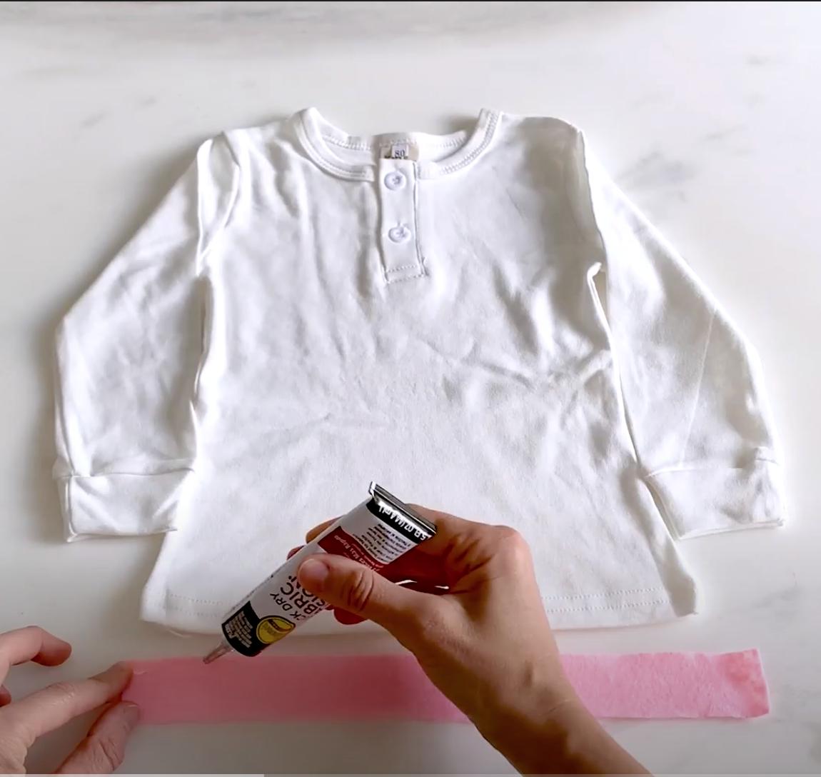 Cut strips of felt and glue onto shirt