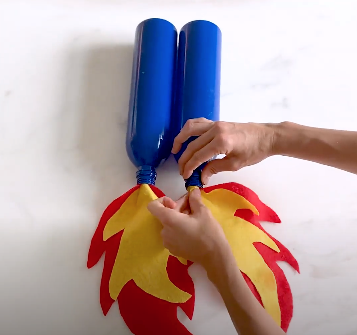 Spray paint bottles and glue flames inside