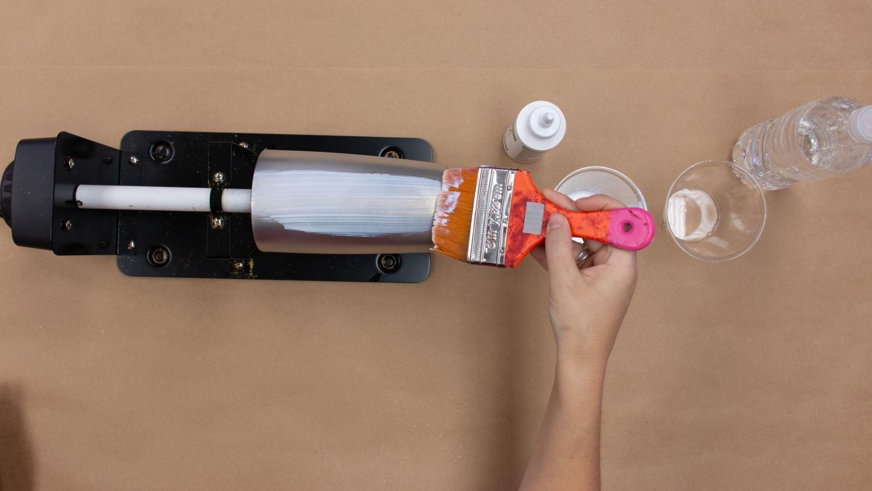 Brush glue mixture onto tumbler
