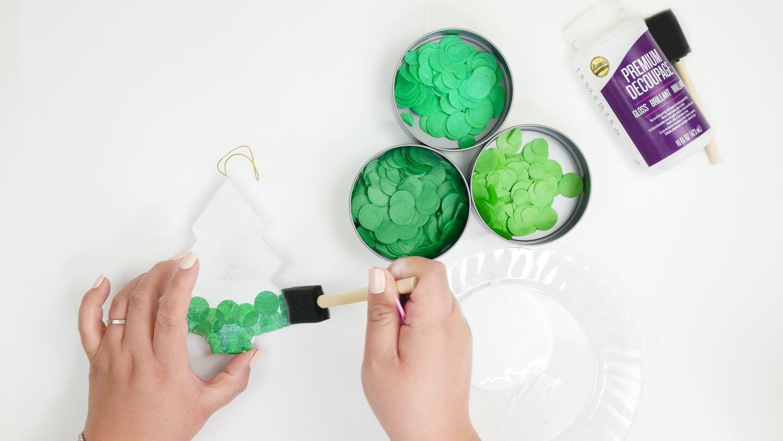 Glue tissue paper circles onto ornament