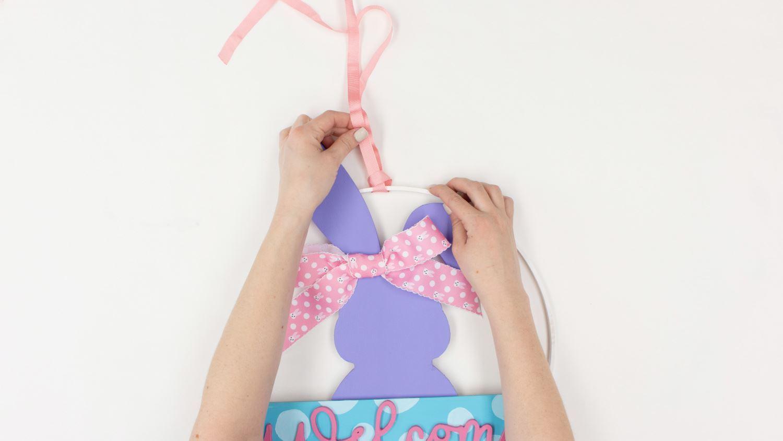 Loop ribbon around hoop for hanger