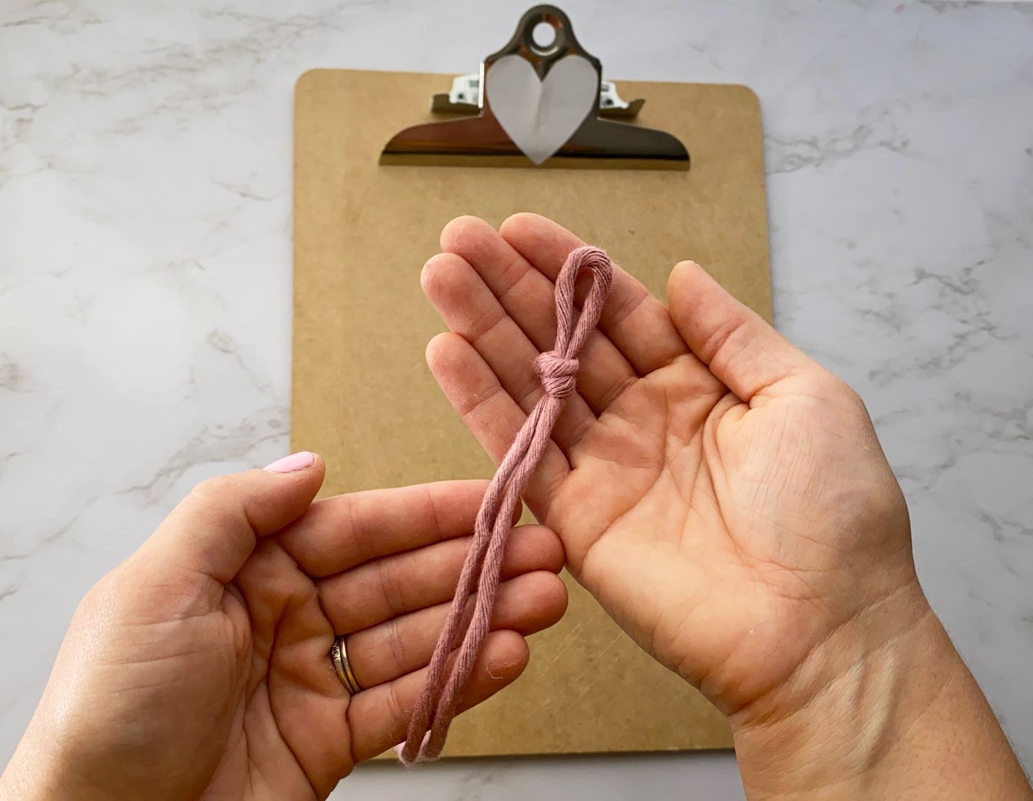 Fold spine rope in half and tie a simple knot