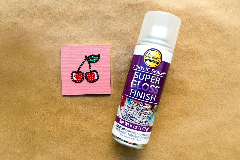 Spray canvas with Aleene's Super Gloss Finish Acrylic Sealer