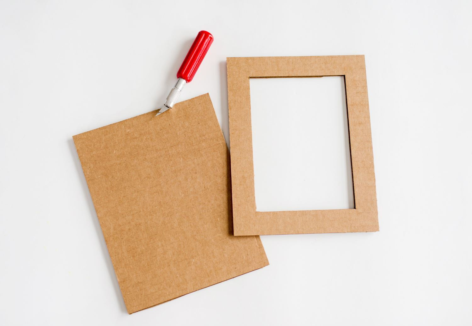 Cut frame pieces from cardboard