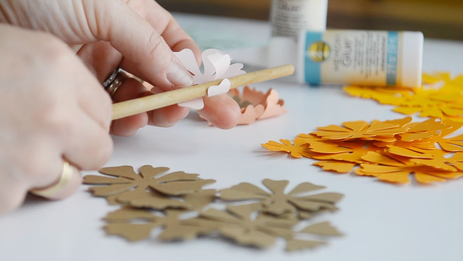 Use a pen to curl flower petals for dimension