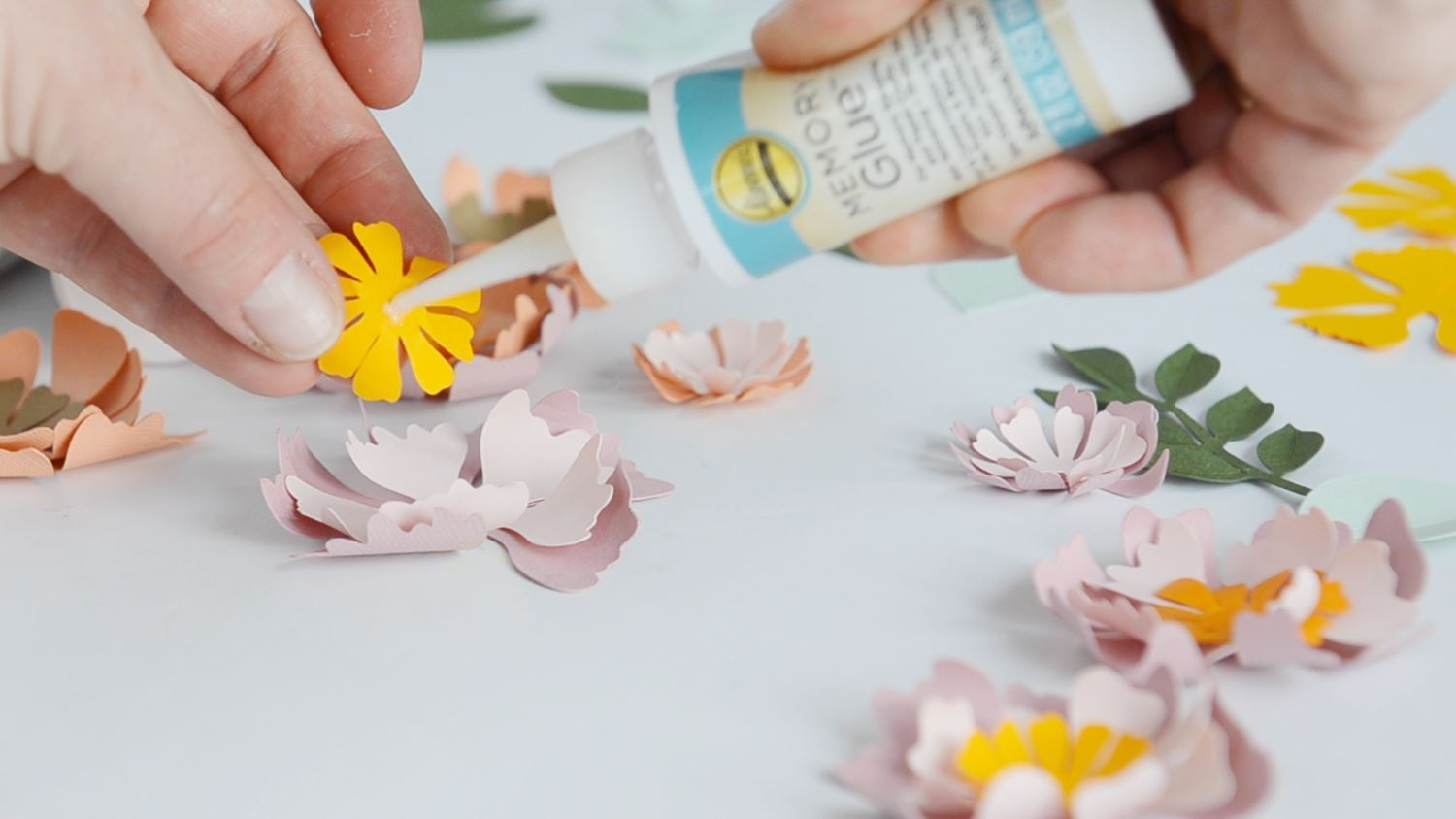 Begin gluing layers of flowers together