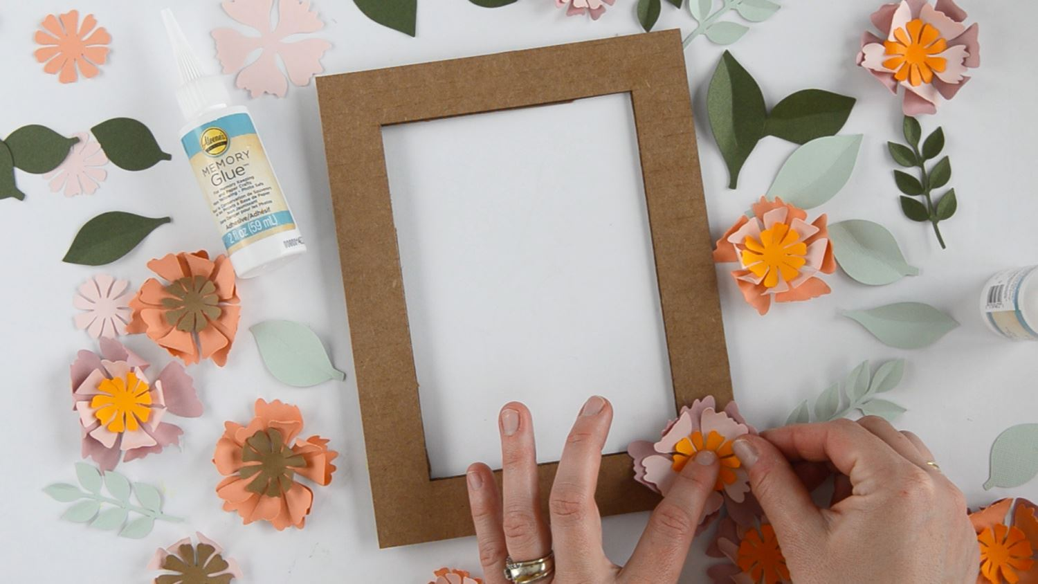 Practice arranging flowers before gluing on frame
