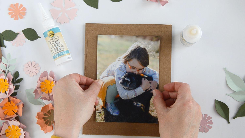 Glue photo to back piece