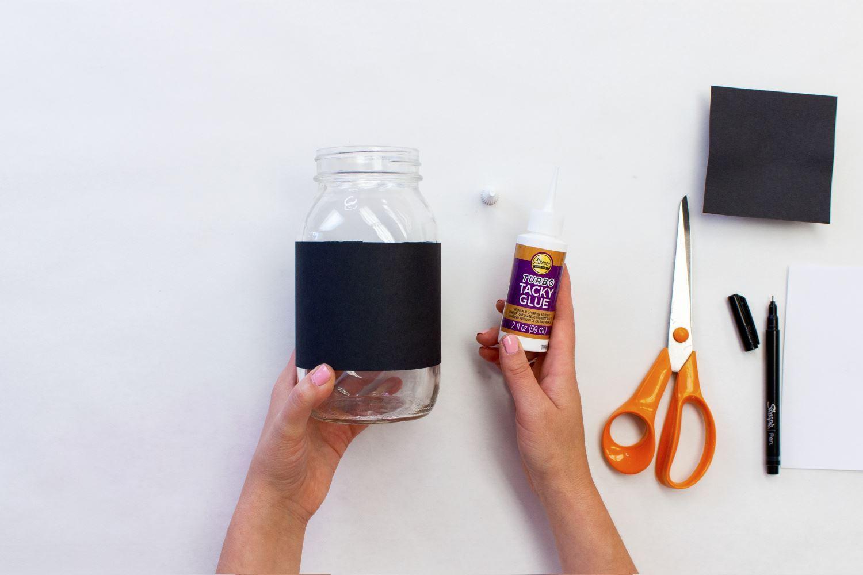Glue paper strip around jar