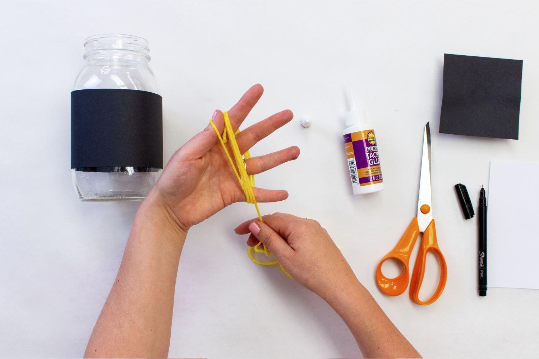Wrap yarn around hand