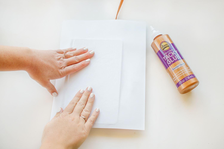 Press image glue side down onto journal