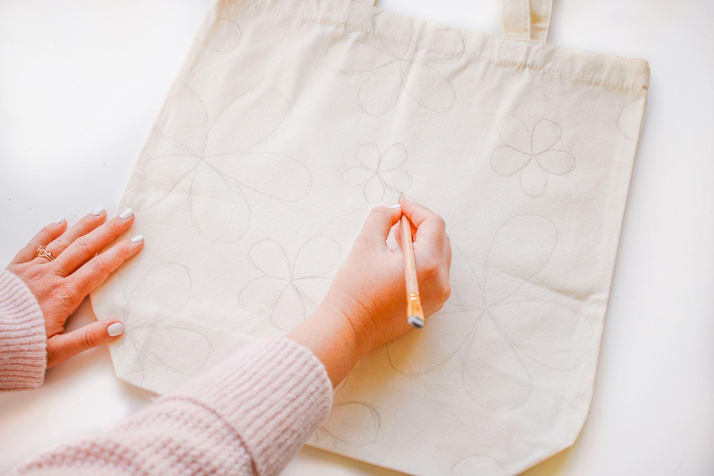 Sketch designs onto tote