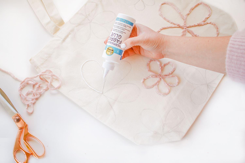 Begin applying glue over designs