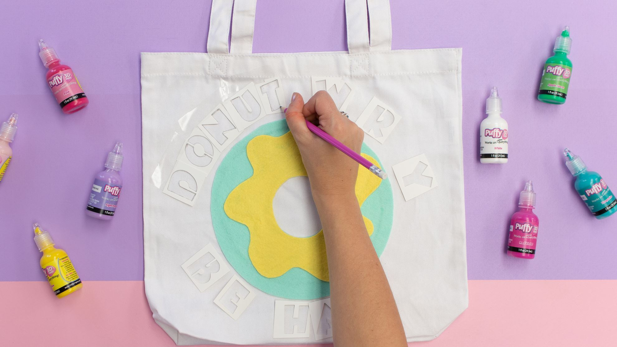 Lightly trace letters onto tote
