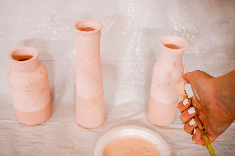 Splatter watered down paint onto vases
