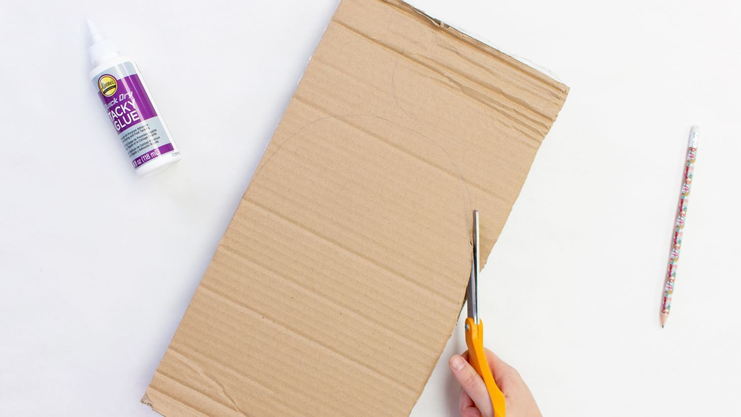 Draw and cut out a U shape from cardboard