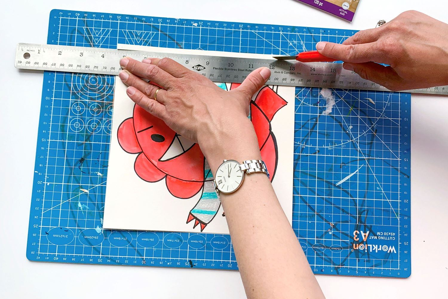 Trim any art that's too large for the frame