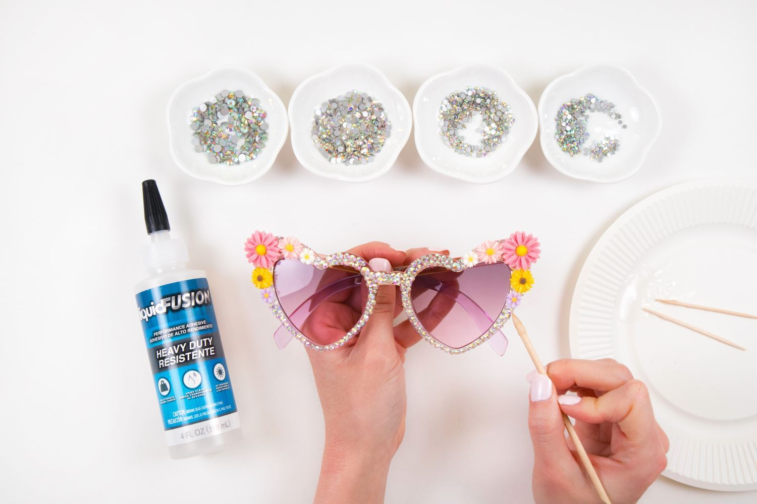 Use waxed skewer to place rhinestones in glue