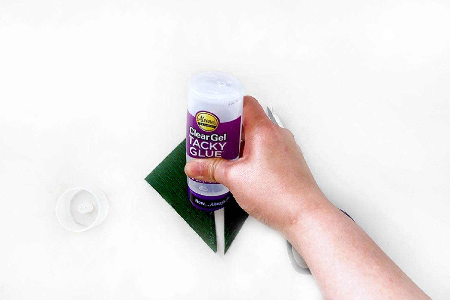 Flip one half over and add glue to edge