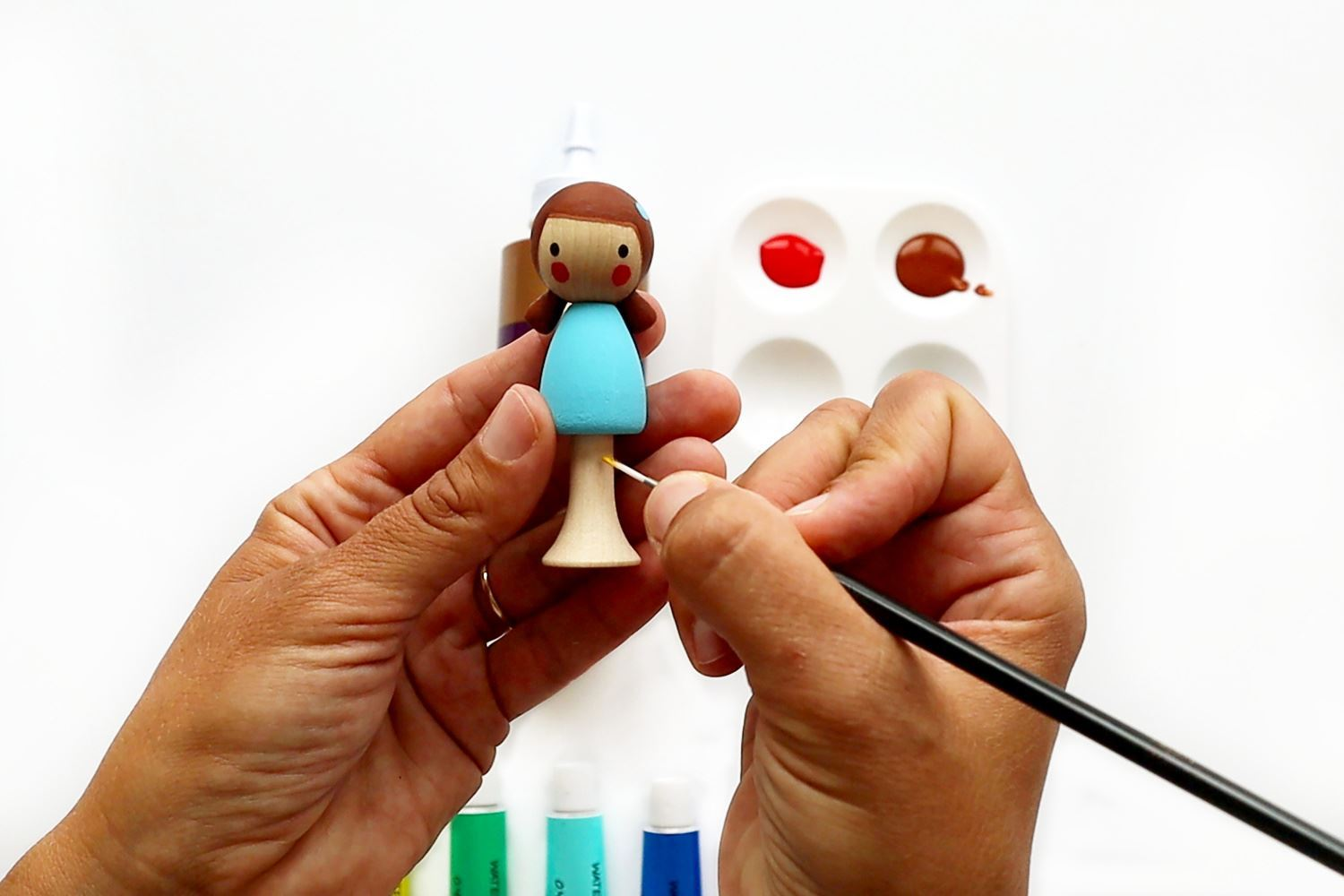 Paint peg doll with acrylic paints