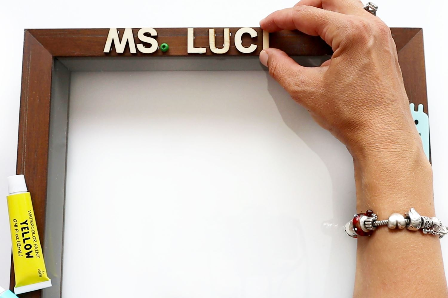 Glue letters in place on frame