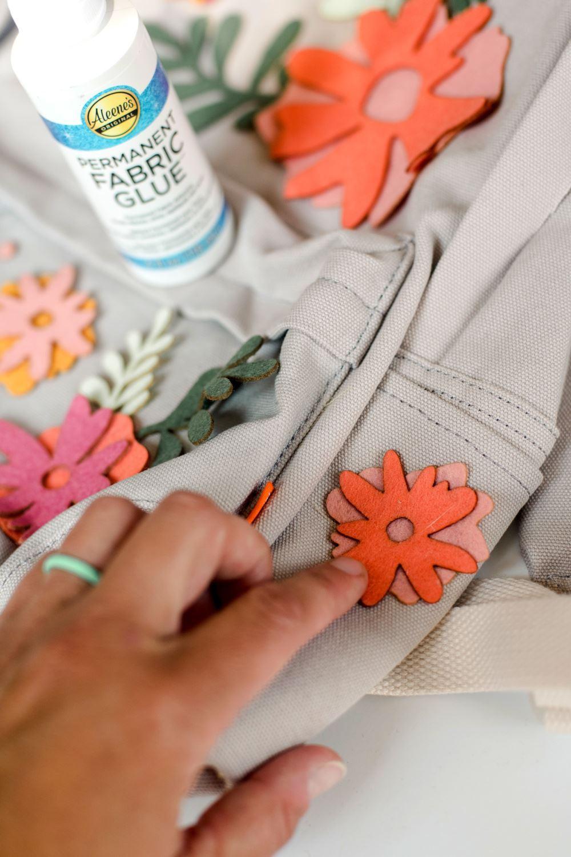Glue entire flower onto backpack