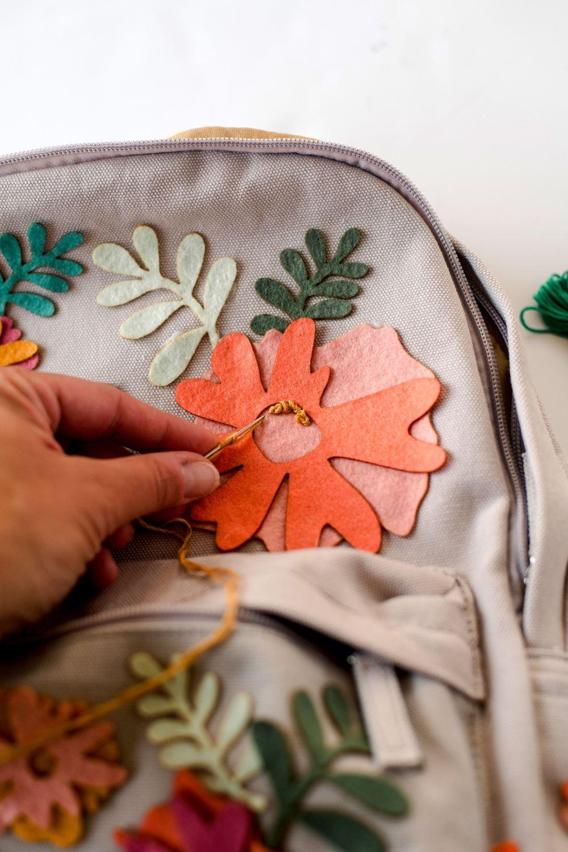 Optional: stitch details onto flowers