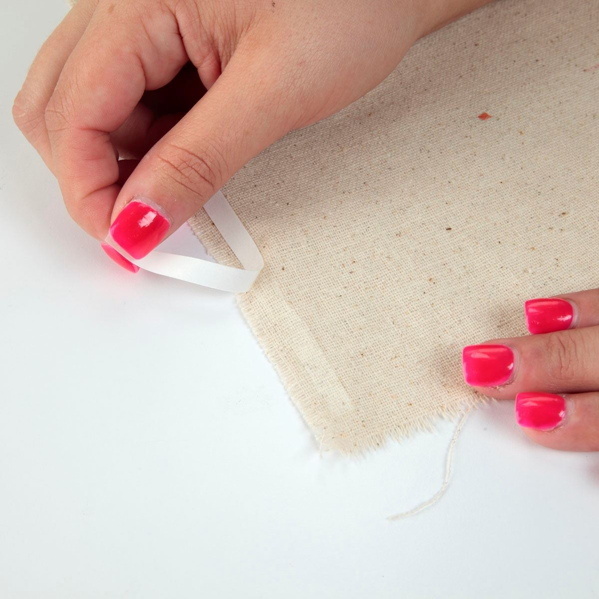 Aleene's® Fabric Fusion® Permanent Fabric Tape application removing protection