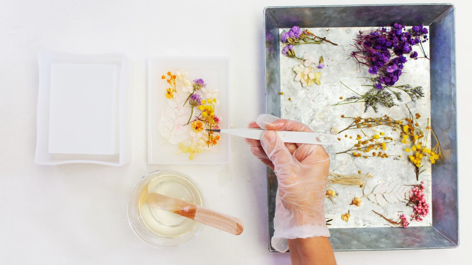 Place flowers into mold and cover with resin