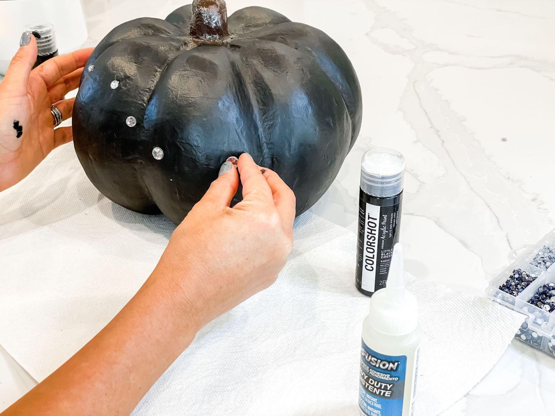 Glue large gems on pumpkin in constellation shape